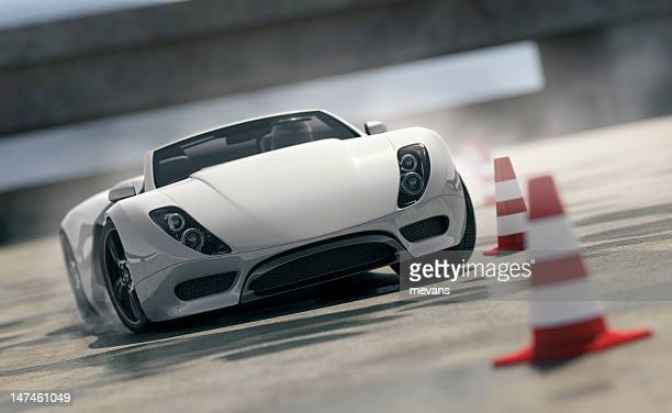 sports car on test track - traffic cone stock pictures, royalty-free photos & images