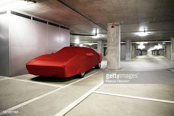 sports car under wraps - parking garage stock pictures, royalty-free photos & images