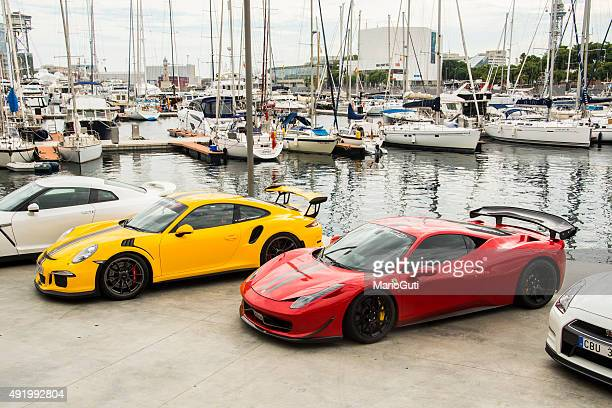 sports cars at the harbor - porsche stock pictures, royalty-free photos & images