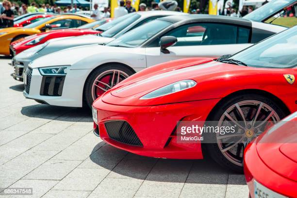 sports cars parked together - ferrari stock pictures, royalty-free photos & images