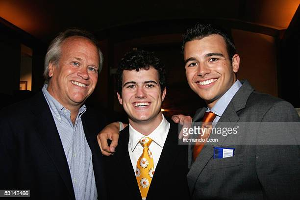 NBC Sports chief Dick Ebersol poses with his sons director Willie Ebersol and producer Charlie Ebersol during the screening of Ithuteng held at the...