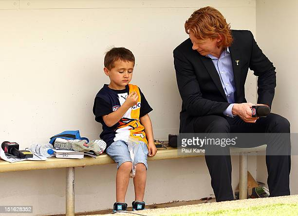 Sports commentator Cameron Ling talks with a young fan during the First AFL Elimination Final match between the West Coast Eagles and the North...