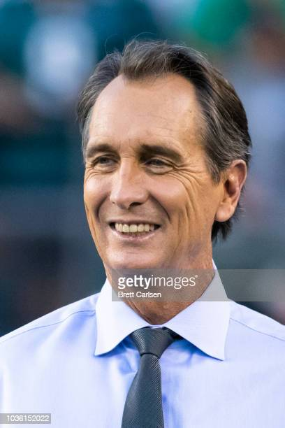 Sports commentator Cris Collinsworth walks on the field before the game between the Philadelphia Eagles and the Atlanta Falcons at Lincoln Financial...
