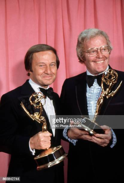 Sports commentator Jim Mckay and Wide World of Sports producer Roone Arledge hold their Emmy Awards in the press room at The 25th Primetime Emmy...