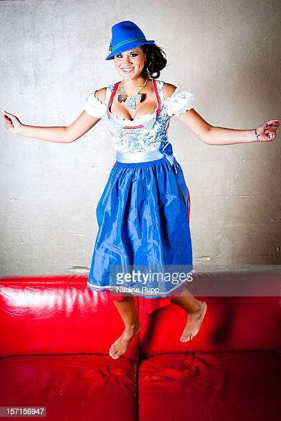 Sports commentator Stephanie 'Steffi' Brungs wears a traditional bavarian dress called Dirndl during a portrait session on August 31 2012 in Munich...