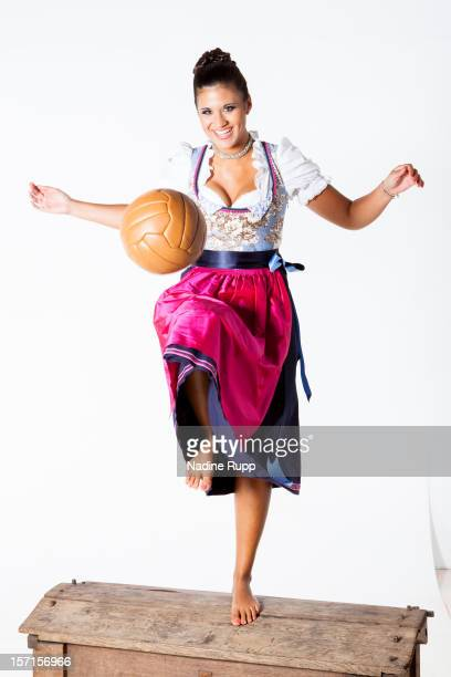 Sports commentator Steffi Brungs wears a traditional bavarian dress called Dirndl during a portrait session on August 31 2012 in Munich Germany