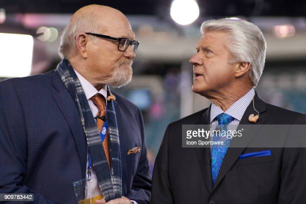 Sports commentator Terry Bradshaw and Jimmy Johnson chat prior to the start of the NFC Championship Game between the Minnesota Vikings and the...