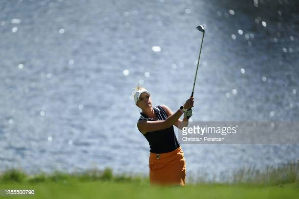 Sports Commentator with NBC Sports Kathryn Tappen chips up to the third green during round one of the American Century Championship at Edgewood Tahoe...