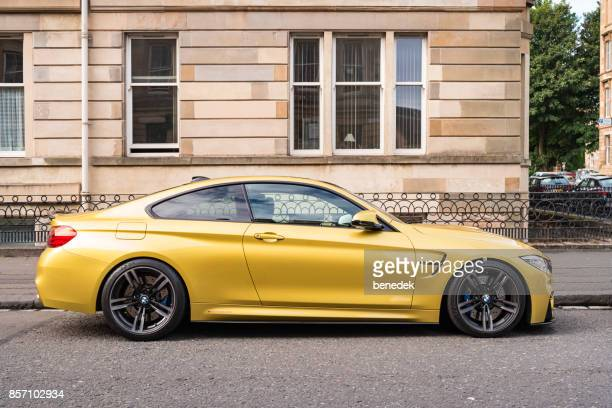 BMW M4 sports coupe side view