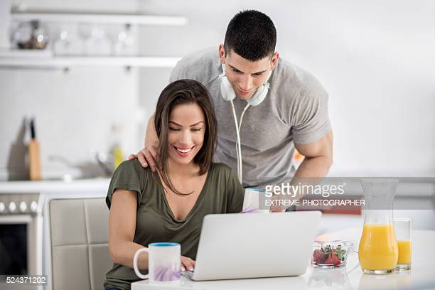 sports couple in the kitchen - mp3 juices stock photos and pictures