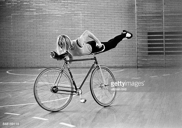 sports cycling Artistic cycling young girl performs an exercise on a bicycle sports hall aged 14 to 18 years DOberhausen DOberhausenOsterfeld Ruhr...