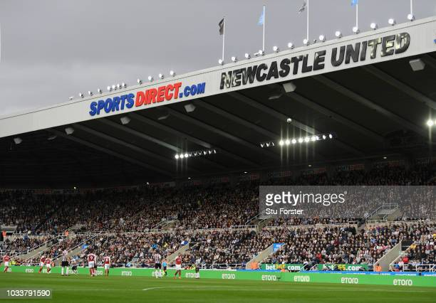 Sports Direct and Newcastle United signing on the East Stand during the Premier League match between Newcastle United and Arsenal FC at St James Park...