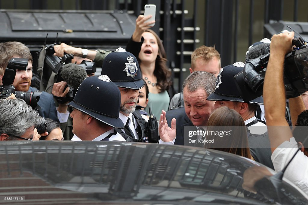 Sports Direct International founder Mike Ashley is escorted into a taxi by police as he leaves Portcullis House after attending a Parliamentary select committee hearing on June 7, 2016 in London, England. Mike Ashley is to face the Business, Innovations and Skills committee on working practices at his Sports Direct Shirebrook Warehouse in Derbyshire. In a letter to his staff he admitted that the centre needed 'improvements' after investigations found that staff had been paid less than the minimum wage and ambulances had been called to the complex 76 times in two years as staff were 'too scared' to call in sick.
