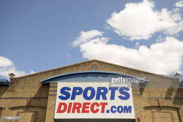 A Sports Direct International Plc sign hangs above the entrance to their store in Crayford UK on Monday July 29 2019 Sports Direct plunged after the...