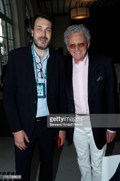 Sports Director at France Television LaurentEric Le Lay and journalist Nelson Monfort attend the 2019 Tennis French Open Women's and Men's Singles...