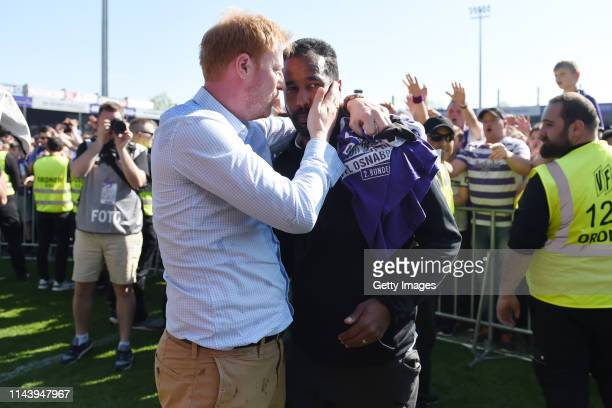 Sports director Benjamin Schmedes and head coach Daniel Thioune Osnabrueck celebrate their teams promotion to the 2 Bundesliga after winning the 3...