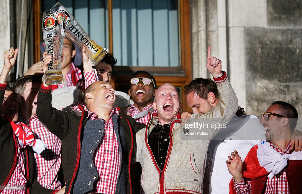 Sports director Matthias Sammer (3rd R) of Bayern Muenchen, Arjen Robben (L), Franck Ribery (R) and the team celebrate the German championship title on the town hall balcony on May 11, 2013 in Munich, Germany.