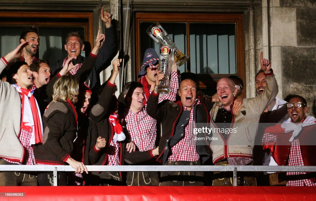 Sports director Matthias Sammer (2nd R) of Bayern Muenchen, Arjen Robben (L), Franck Ribery (R) and the team celebrate the German championship title on the town hall balcony at Marienplatz on May 11, 2013 in Munich, Germany.