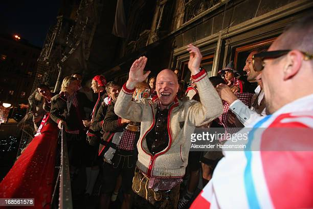Sports director Matthias Sammer of Bayern Muenchen celebrates with Franck Ribery and his team winning the German championship title on the town hall...