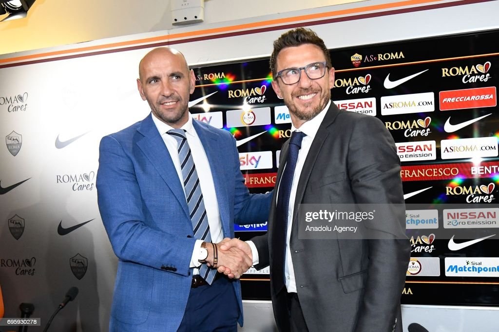 Sports director of AS Roma Ramon Rodriguez Verdejo Monchi (L) and AS Roma's new head coach Eusebio Di Francesco (R) shake hands as they pose for a photo after a press conference at Fulvio Bernardini Sport Facility in Trigoria district of Rome, Italy on June 14, 2017.