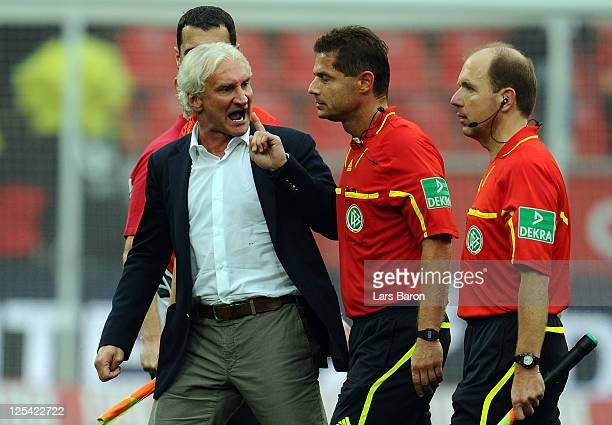 Sports director Rudi Voeller of LEverkusen discusses with referee Guenter Perl after loosing the Bundesliga match between Bayer 04 Leverkusen and 1...