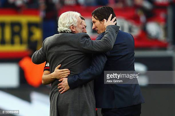 Sports director Rudi Voeller of Leverkusen hugs head coach Roger Schmidt after the Bundesliga match between Bayer 04 Leverkusen and Hamburger SV at...