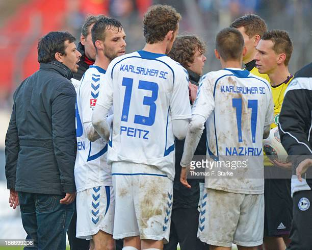 Sports director Samir Arabi and head coach Stefan Kraemer of Bielefeld argue with referee Christian Bandurski after the Second Bundesliga match...