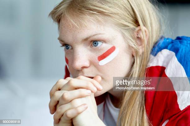 sports enthusiast watching match with hands clasped in front of mouth - 支持者 ストックフォトと画像