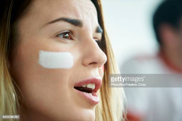 sports enthusiast watching televised match - football body paint stock photos and pictures