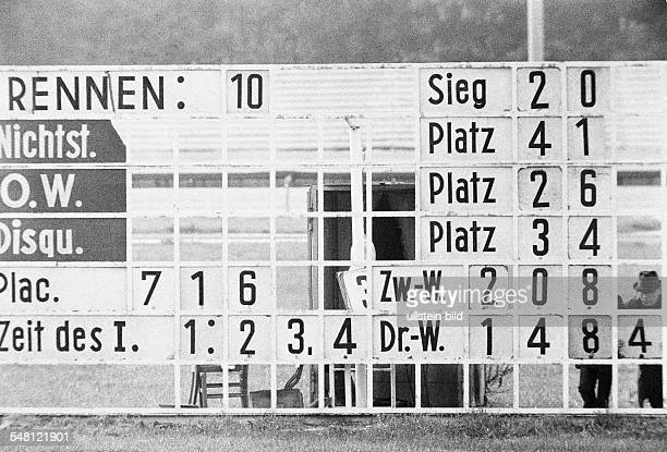 Sports, equestrianism, racecourse Dinslaken, trotting race 1973, horse-racing bet, scoreboard shows the results and the betting odds, D-Dinslaken,...