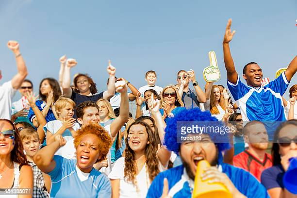 sports: fans cheer for their team during local sporting event. - cheering stock pictures, royalty-free photos & images