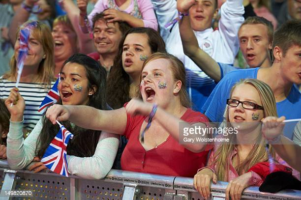 Sports fans cheer on Jessica Ennis as she competes for an Olympic Gold Medalduring Sheftival at Don Valley Stadium on August 4 2012 in Sheffield...