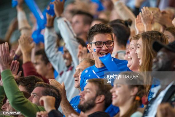 sports fans cheering and celebrating - sports event stock pictures, royalty-free photos & images
