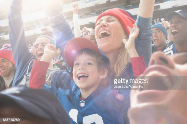 Sports fans cheering in stadium