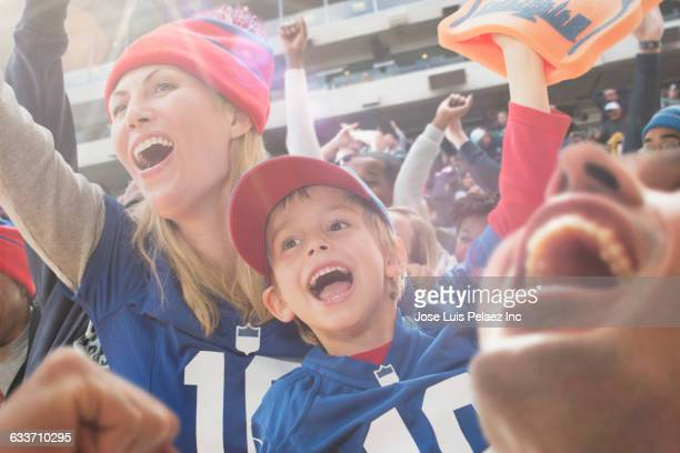 sports fans cheering in stadium - cheering ストックフォトと画像