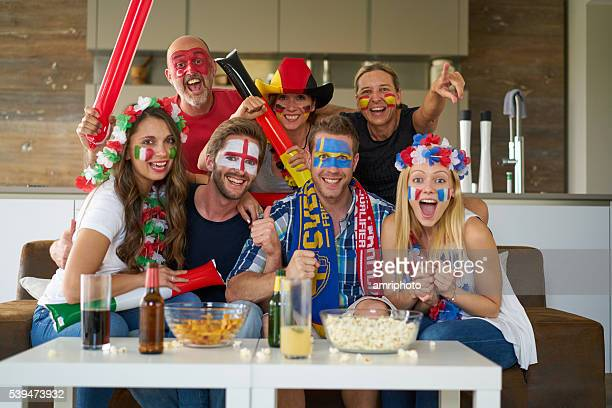 sports fans in front of tv