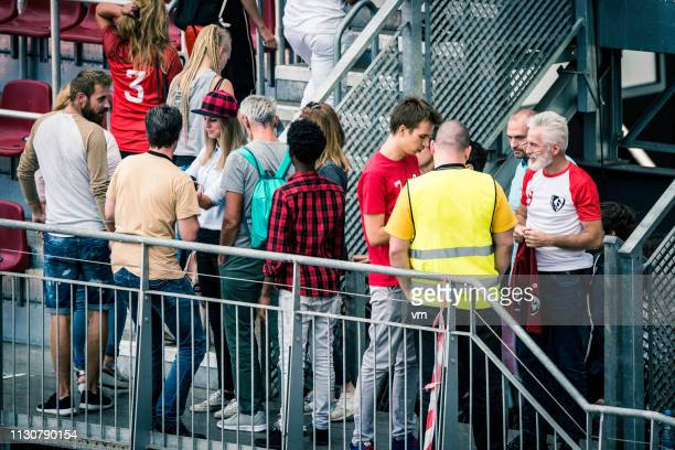 sports fans walking onto stadium bleachers - sports event stock pictures, royalty-free photos & images