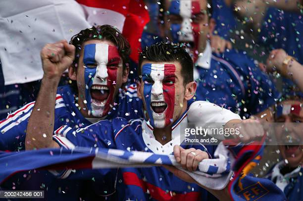 sports fans with french flags painted on faces, celebrating - fan enthusiast stock pictures, royalty-free photos & images