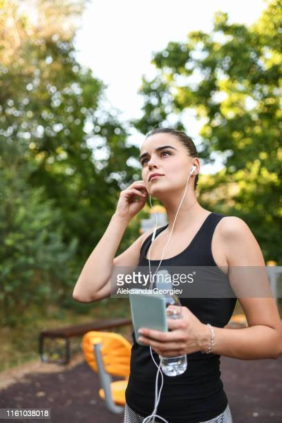 sports female ready with water and smartphone to start training - colors soundtrack stock pictures, royalty-free photos & images