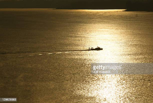A sports fisherman tries his luck early on October 19 taking advantage of the last days of Indian summer on Liptovska Mara dam The dam is Slovakia's...