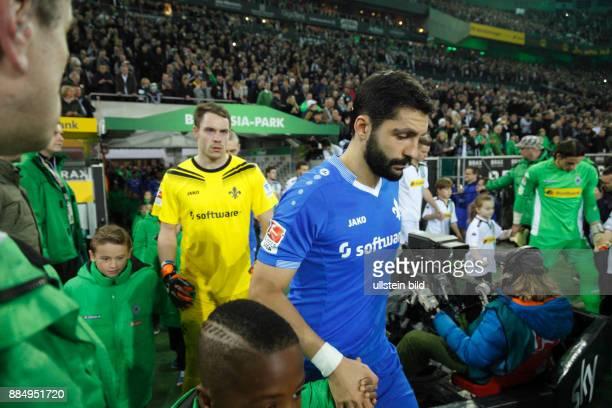 sports football Bundesliga 2015/2016 Borussia Moenchengladbach versus SV Darmstadt 98 32 Stadium Borussia Park runningin of the teams ahead Aytac...