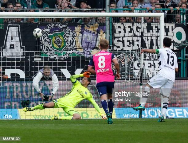 sports football Bundesliga 2016/2017 Borussia Moenchengladbach versus Hamburger SV 00 Stadium Borussia Park team leader Lars Stindl right shots the...