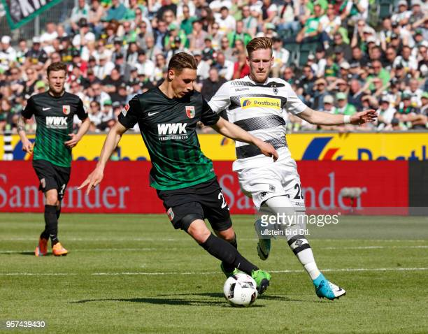 sports football Bundesliga 2016/2017 Borussia Moenchengladbach vs FC Augsburg 11 Stadium Borussia Park scene of the match Dominik Kohr left ahead and...