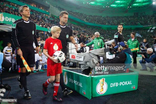 sports football DFB Cup 2016/2017 Round 2 Borussia Moenchengladbach versus VfB Stuttgart 20 Stadium Borussia Park teams come in cameraman runningin...