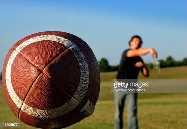 sports football quarterback pass - quarterback stock photos and pictures