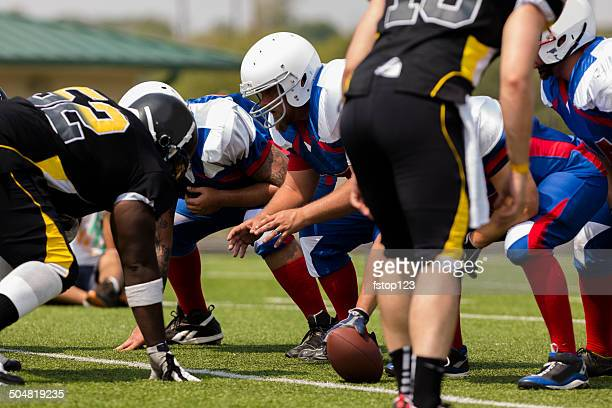 sports: football teams prepare for a play.  line of scrimmage. - center athlete stock pictures, royalty-free photos & images