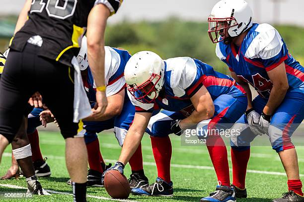 sports: football teams prepare for a play.  line of scrimmage. - quarterback stock pictures, royalty-free photos & images