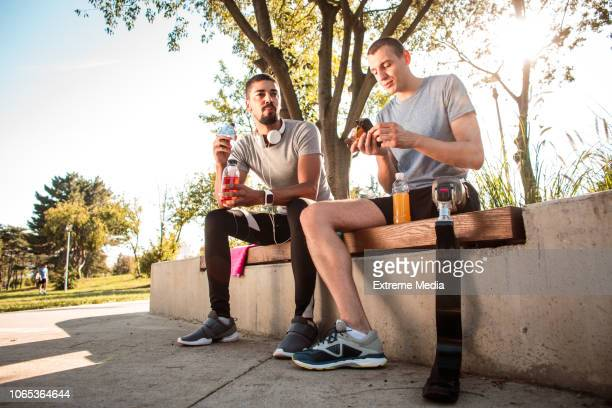 Sports friends resting after training