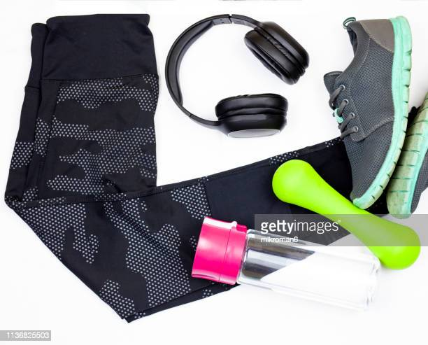 sports gear ready for the gym on white background - レギンス ストックフォトと画像