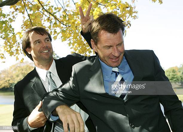 Sports golf announcers Paul Azinger and Nick Faldo clown around during the first round of the Tour Championship at East Lake Golf Club on November 2...